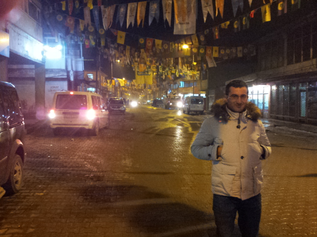 With elections only a month away political flags line the streets behind Ali Osaman