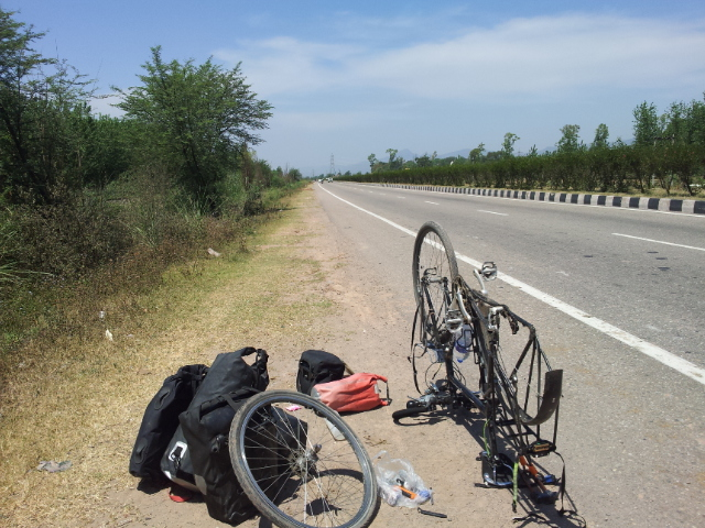 Not a puncture this time, the valve on the rear inner tube capitulated in the heat.