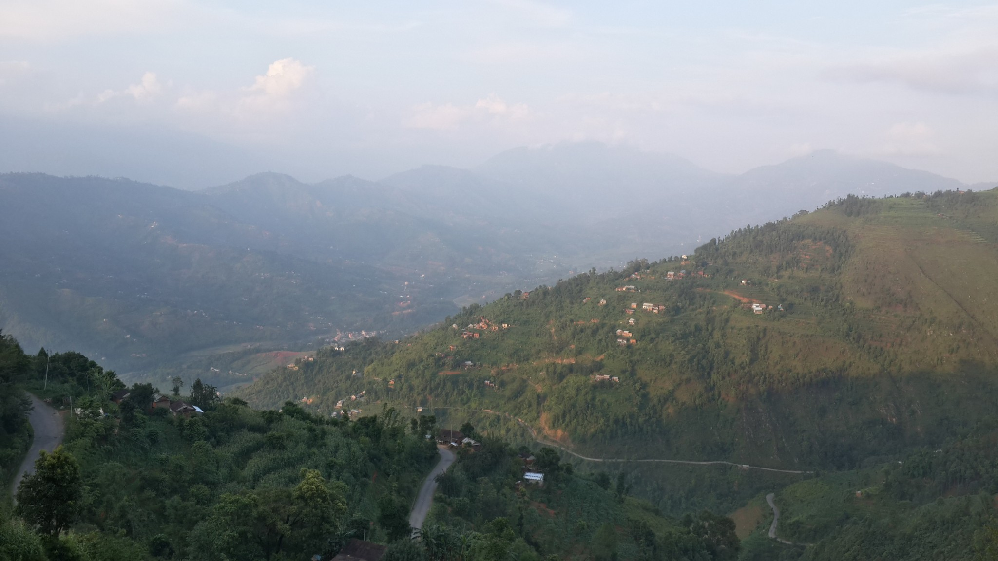 The various sections of road you can see are all parts of the same winding road. Kathmandu valley lies beyond sight, twenty miles to go.