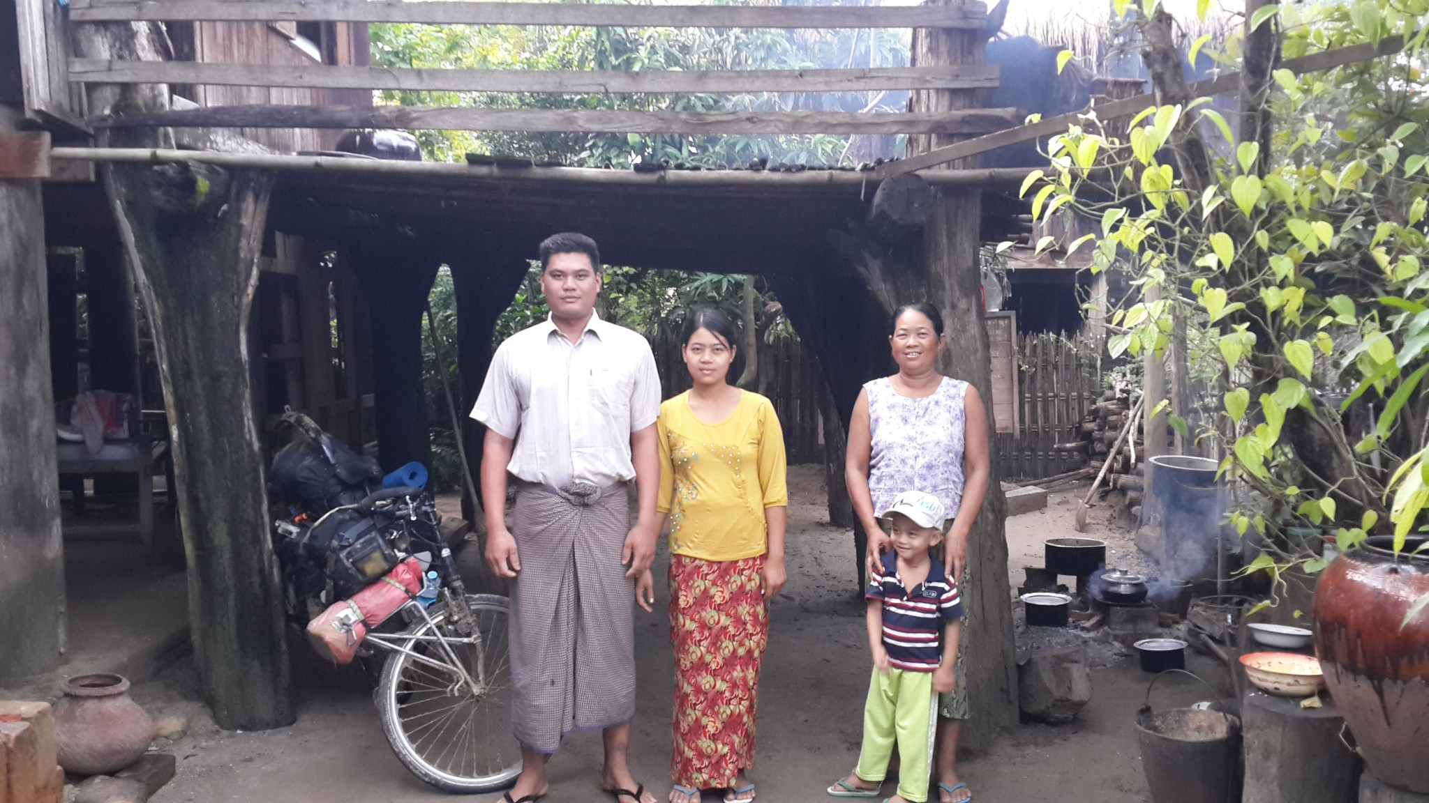 Aung, his wife, mother-in-law and son.