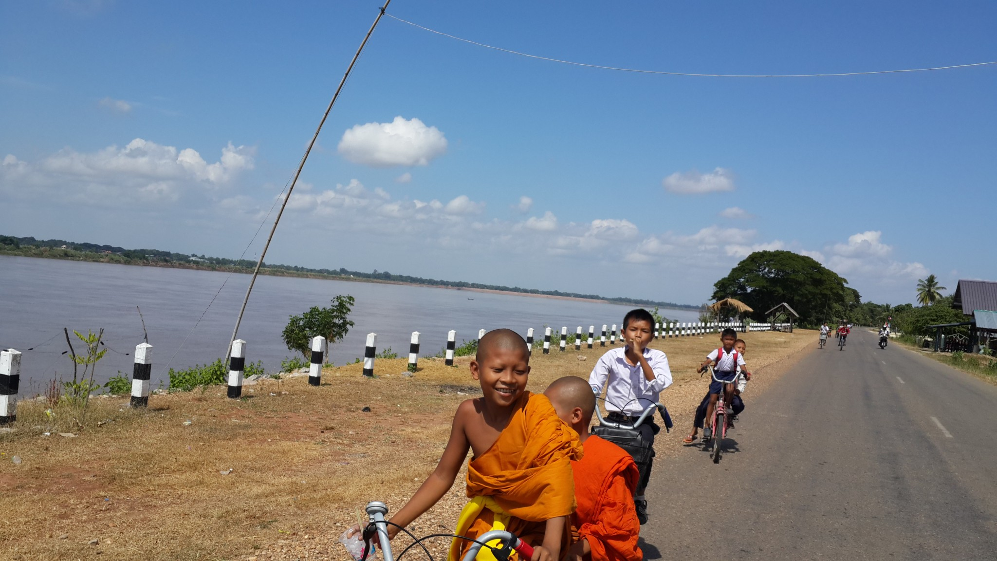 Cycling along the Mekong with hoards of school kids on their way home. The saffron robes and shaven heads worn by Theravada Buddhist monks symbolises simplicity and detachment of materialism.