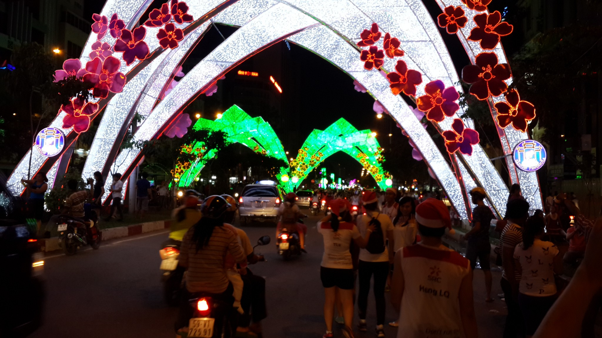 A night out with the Sunday Running Club (folks in the Santa hats) delivering sweets to kids in Ho Chi Minh.